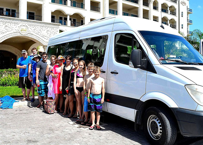Larry and his family leaving the hotel in their Cozumel taxi excursion.